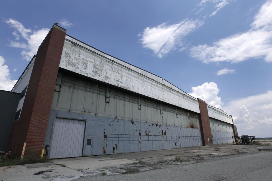 FILE - In this July 17, 2013 file photo is part of the former Willow Run Bomber Plant at Willow Run Airport in Ypsilanti Township, Mich. The factory went back to making automobiles after the World War II ended, and it did so for more than a half-century under the General Motors name before closing for good in 2010. A group trying to save the Detroit-area factory where Rosie the Riveter became an icon of American female empowerment during the war said Friday, March 28, 2014 that it must raise $1.5 million in the next few weeks to save the site from being demolished. (AP Photo/File)