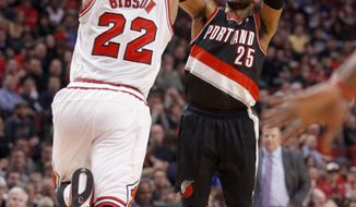 Portland Trail Blazers guard Mo Williams (25) shoots as Chicago Bulls forward Taj Gibson (22) defends during the first half of an NBA basketball game Friday, March 28, 2014, in Chicago. (AP Photo/Charles Rex Arbogast)