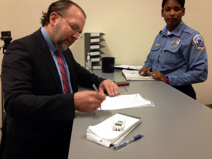 Businessman Mark Witaschek enrolls in D.C. Gun Offenders Registry at the Metropolitan Police Department. March 28, 2013.