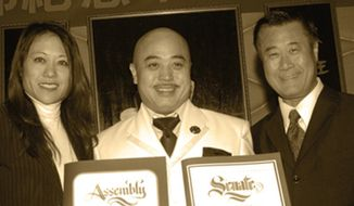 "In this March 2011 photo, Raymond ""Shrimp Boy"" Chow, center, poses with state Senator Leland Yee, right, and state Assembly member Fiona Ma, left, at the Chee Kung Tong spring banquet in San Francisco. Investigators say Chow is the leader and the dragonhead of one of the most powerful Asian gangs in North America. Chow's gang is said to have lured state Sen. Leland Yee into its clutches through money and campaign contributions in exchange for legislative help, as Yee sought to build his campaign coffers to run for California secretary of state. Born in Hong Kong in 1960, Chow came to the United States at 16 and was reportedly nicknamed ""Shrimp Boy"" by his grandmother, in part due to his small stature. (AP Photo/Sing Tao Daily)"