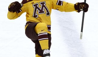 Minnesota defense Michael Brodzinski reacts after scoring on Robert Morris goalie Dalton Izyk during the first period of an NCAA West college regional hockey game in St. Paul, Minn., Saturday, March 29, 2014. (AP Photo/Ann Heisenfelt)