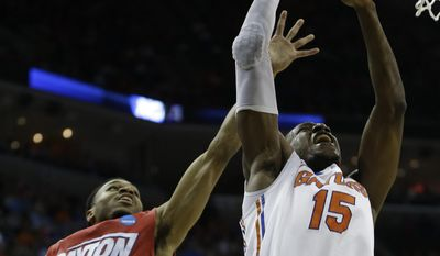 Florida forward Will Yeguete (15) shoots against Dayton guard Vee Sanford (43) during the first half in a regional final game at the NCAA college basketball tournament, Saturday, March 29, 2014, in Memphis, Tenn. (AP Photo/Mark Humphrey)