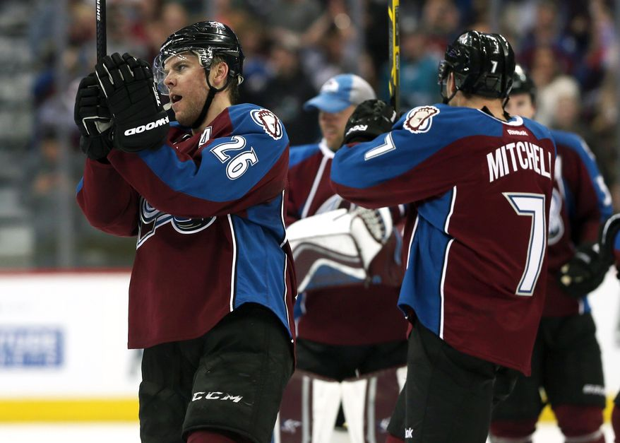 Colorado Avalanche center Paul Stastny, left, joins center John Mitchell in celebrating after the Avalanche's 3-2 victory over the San Jose Sharks in an NHL hockey game in Denver on Saturday, March 29, 2014. The win secures the Avalanche will make their first appearance in the NHL Playoffs since 2010. (AP Photo/David Zalubowski)