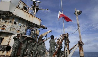"Philippine Marines deployed on the Philippine Navy ship LT 57 Sierra Madre practice the ""relieving the watch"" ceremony after the Philippine Government vessel AM700 successfully dockied beside it off Second Thomas Shoal, locally known as Ayungin Shoal,  Saturday, March 29, 2014 off South China Sea on the West Philippine Sea. A Philippine government ship slipped past a Chinese coast guard blockade Saturday and brought food and fresh troops to a marooned navy ship used as a base by Filipino troops to bolster the country's territorial claims in the disputed South China Sea. (AP Photo/Bullit Marquez)"