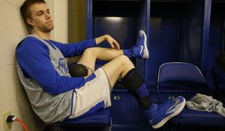 Kentucky's Jon Hood waits to be interviewed during a media session for the NCAA Midwest Regional final college basketball tournament game Saturday, March 29, 2014, in Indianapolis. Kentucky plays Michigan in the final on Sunday, March 30, 2014. (AP Photo/Michael Conroy)