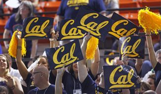 California fans wave signs during the NCAA men's swimming and diving championships Saturday, March 29, 2014, in Austin, Texas. California won the team title. (AP Photo/Michael Thomas