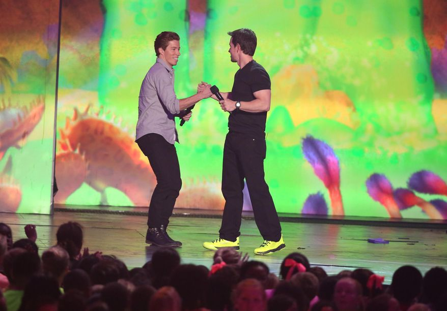 Shaun White, left, and Mark Wahlberg on stage at the 27th annual Kids' Choice Awards at the Galen Center on Saturday, March 29, 2014, in Los Angeles. (Photo by Matt Sayles/Invision/AP)