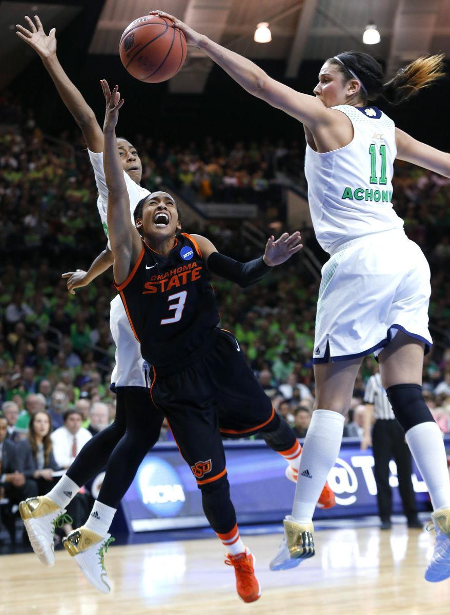 Notre Dame forward Natalie Achonwa (11) blocks a shot by Oklahoma State guard Tiffany Bias (3) as guard Jewell Loyd, at rear, helps to defend during the second half of a regional semifinal in the NCAA college basketball tournament at the Purcell Pavilion in South Bend, Ind., Saturday, March 29, 2014. (AP Photo/Paul Sancya)