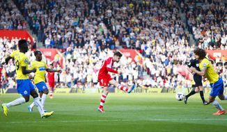 Southampton's Adam Lallana, center, shoots to score his team's third goal during their English Premier League soccer match at St Mary's, Southampton, England, Saturday, March 29, 2014. (AP Photo/Chris Ison, PA Wire)    UNITED KINGDOM OUT    -    NO SALES   -   NO ARCHIVES