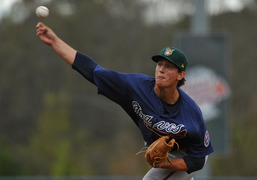 Rome minor league Future Stars pitcher Lucas Sims delivers to the Atlanta Braves during the fourth inning of their exhibition baseball game Saturday, March 29, 2014, in Rome, Ga. (AP Photo/David Tulis)