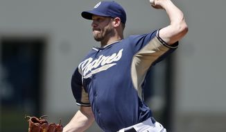 San Diego Padres starter Eric Stults pitches to the Cleveland Indians in the first inning of the final spring training exhibition baseball game, Saturday, March 29, 2014, in San Diego. Stults threw four innings and allowed one run on one hit.  (AP Photo/Lenny Ignelzi)