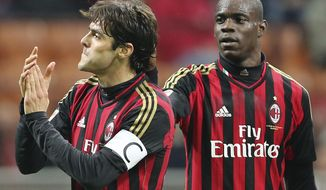 AC Milan Brazilian forward Kaka, left, celebrates with his teammate forward Mario Balotelli after scoring during the Serie A soccer match between AC Milan and Chievo Verona at the San Siro stadium in Milan, Italy, Saturday, March 29, 2014. (AP Photo/Antonio Calanni)