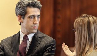 FILE - In this May 6, 2013 file photo, Illinois state Sen. Daniel Biss, D-Evanston, speaks with a legislative staffer at the state Capitol in Springfield. Illinois lawmakers are advancing legislation that would give most private-sector employees access to retirement plans through a government program. The proposal sponsored by Biss passed a Senate committee earlier this month after lengthy debate. Biss says the program would allow millions to save for retirement with little cost to government and businesses. (AP Photo/Seth Perlman, File)