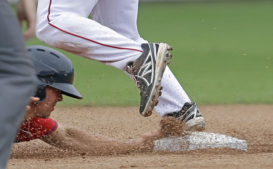 Minnesota Twins' Levi Michael is caught out trying to return to second base as Boston Red Sox second baseman Heiker Meneses covers on a double play off the bat of the Twins' Josh Willingham during the sixth inning of an exhibition baseball game in Fort Myers, Fla., Saturday, March 29, 2014. (AP Photo/Gerald Herbert)