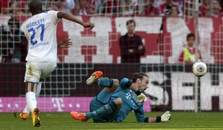 Hoffenheim's Anthony Modeste of France scores his side's opening goal during the German first division Bundesliga soccer match between FC Bayern Munich and TSG  1899 Hoffenheim, in Munich, southern Germany, Saturday, March 29, 2014. (AP Photo/Matthias Schrader)