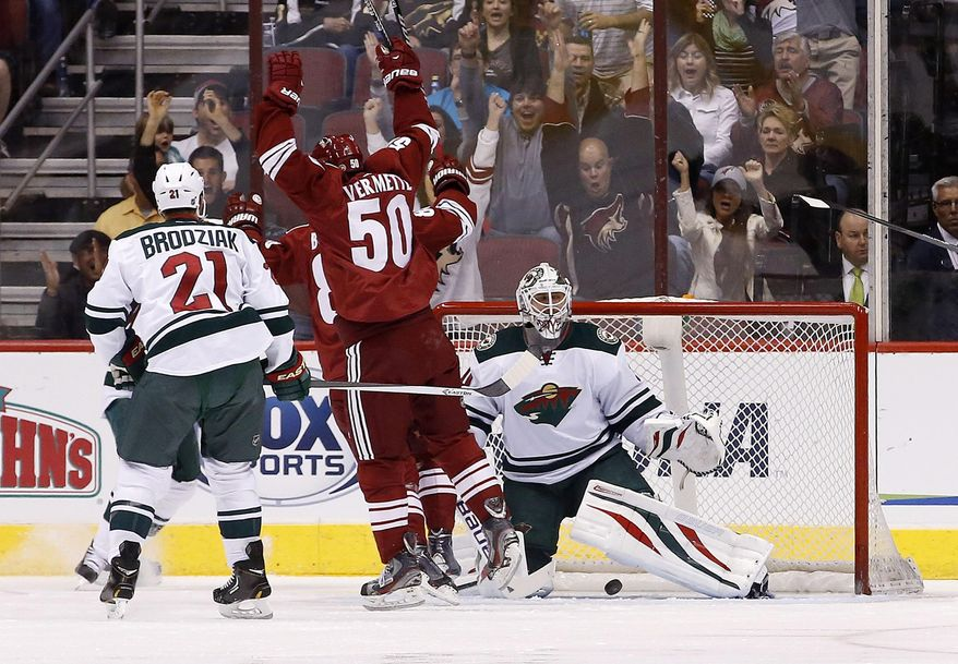 Phoenix Coyotes' Antoine Vermette (50) celebrates a goal by teammate Mikkel Boedker against Minnesota Wild's Ilya Bryzgalov, right, of Russia, as Wild's Kyle Brodziak (21) watchj during the first period of an NHL hockey game, Saturday, March 29, 2014, in Glendale, Ariz. (AP Photo/Ross D. Franklin)