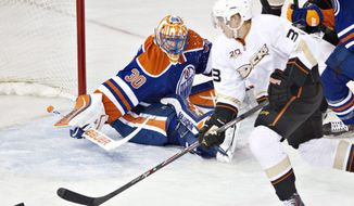 Anaheim Ducks' Jakob Silfverberg (33) is stopped by Edmonton Oilers' Ben Scrivens (30) during second-period NHL hockey game action in Edmonton, Alberta, Friday, March 28, 2014. (AP Photo/The Canadian Press, Jason Franson)