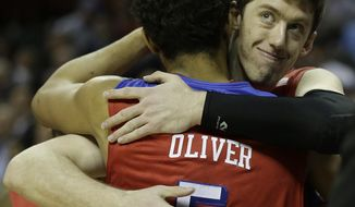 Dayton's Devin Oliver (5) embraces Matt Kavanaugh after the second half in a regional final game against Florida at the NCAA college basketball tournament, Saturday, March 29, 2014, in Memphis, Tenn. Florida won 62-52. (AP Photo/Mark Humphrey)