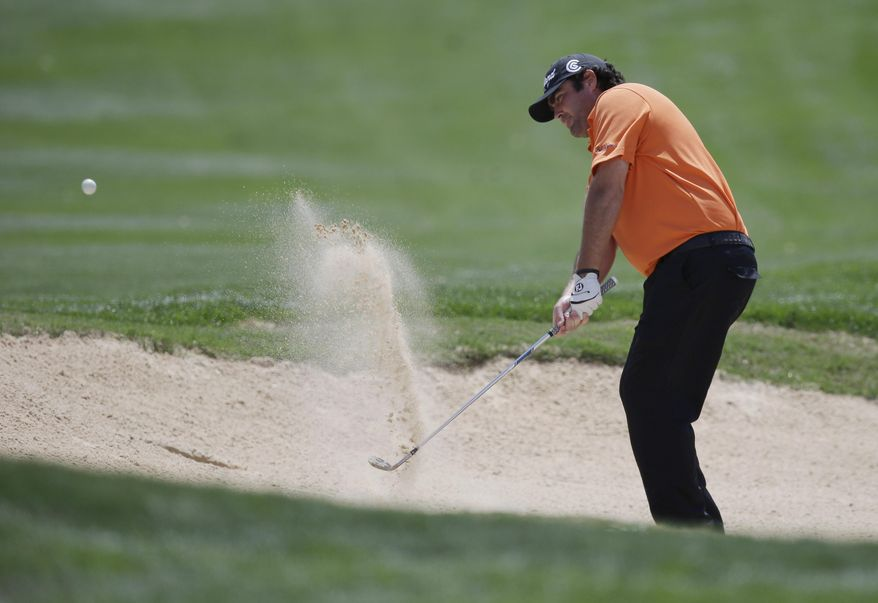 CORRECTS SPELLING OF LAST NAME TO BOWDITCH, INSTEAD OF BOWDICH - Steven Bowditch, of Australia, hits from a sand trap on the eighth hole during the third round of the Texas Open golf tournament, Saturday, March 29, 2014, in San Antonio. (AP Photo/Eric Gay)