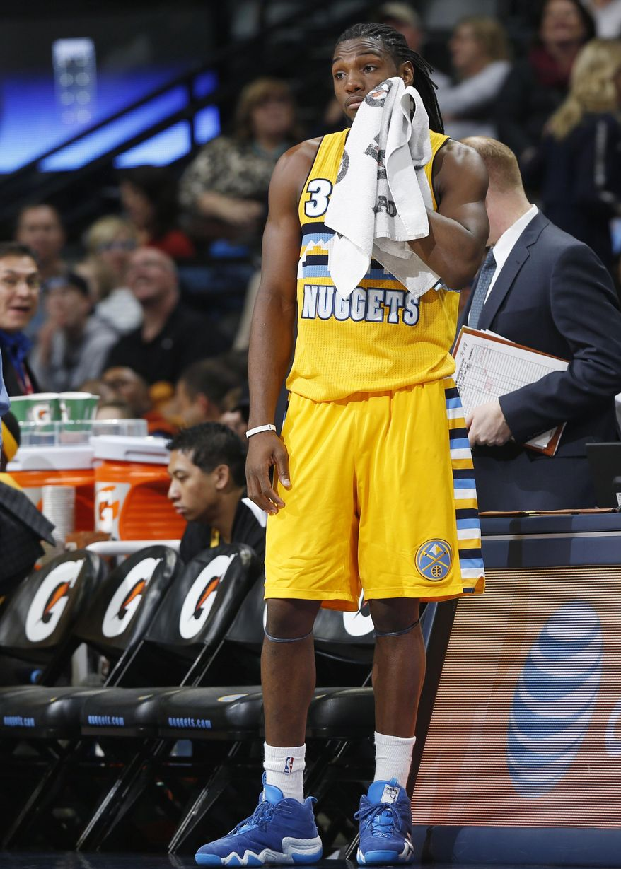 Denver Nuggets forward Kenneth Faried stands on the sideline during a timeout in the fourth quarter of the San Antonio Spurs' 133-102 victory in an NBA basketball game in Denver on Friday, March 28, 2014. (AP Photo/David Zalubowski)
