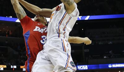 Florida guard Scottie Wilbekin (5) shoots against Dayton guard Kyle Davis (3) during the first half in a regional final game at the NCAA college basketball tournament, Saturday, March 29, 2014, in Memphis, Tenn. (AP Photo/Mark Humphrey)