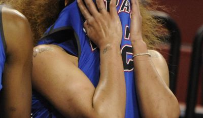 DePaul's Brittany Hrynko (12) covers her face during the second half of a regional semifinal against Texas A&M in the NCAA women's college basketball tournament Saturday, March 29. 2014, in Lincoln, Neb. (AP Photo/Dave Weaver)