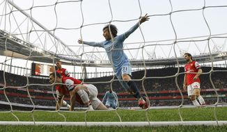 Manchester City's David Silva celebrates scoring a goal during the English Premier League soccer match between Arsenal and Manchester City at the Emirates stadium in London, Saturday, March 29, 2014. (AP Photo/Kirsty Wigglesworth)