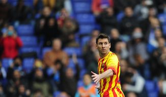 FC Barcelona's Lionel Messi gestures after scoring a penalty during a Spanish La Liga soccer match against Espanyol at Cornella-El Prat stadium in Cornella Llobregat, Spain, Saturday, March 29, 2014. (AP Photo/Manu Fernandez)