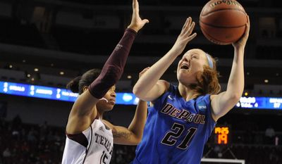 DePaul's Megan Rogowski (21) shoots in front of Texas A&M's Tori Scott (15) during the second half of a regional semifinal in the NCAA women's college basketball tournament Saturday, March 29. 2014, in Lincoln, Neb. (AP Photo/Dave Weaver)