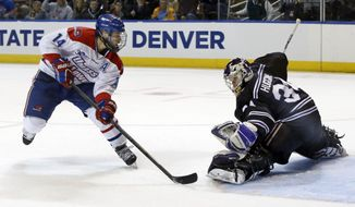 UMass Lowell's Joseph Pendenza (14) puts the puck past Minnesota State, Mankato goaltender Cole Huggins in the first period of an NCAA Northeast Regional men's hockey game in Worcester, Mass., Saturday, March 29, 2014. (AP Photo/Elise Amendola)