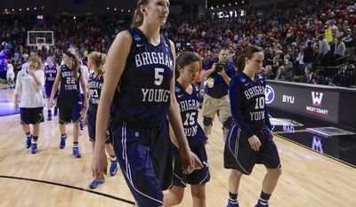 BYU's Jennifer Hamson (5), Kylie Maeda (15) and Stephanie Rovetti (10) walk off the court following BYU's 70-51 loss to Connecticut in a regional semifinal in the NCAA women's college basketball tournament in Lincoln, Neb., Saturday, March 29, 2014. (AP Photo/Nati Harnik)
