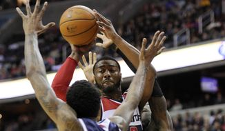 Washington Wizards guard John Wall (2) looks to pass against Atlanta Hawks guard Louis Williams (3) during the second half of an NBA basketball game, Saturday, March 29, 2014, in Washington. The Wizards won 101-97. (AP Photo/Nick Wass)