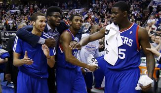 From left to right, Philadelphia 76ers' Michael Carter-Williams, Nerlens Noel, Hollis Thompson and Henry Sims celebrate in the final seconds of an NBA basketball game against the Detroit Pistons, Saturday, March 29, 2014, in Philadelphia. Philadelphia won 123-98, breaking a 26-game losing streak. (AP Photo/Matt Slocum)