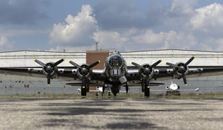"""** FILE ** In this July 17, 2013, file photo is the B-17G """"Yankee Lady"""" in front of the old Willow Run Bomber Plant at Willow Run Airport in Ypsilanti Township, Mich. (AP Photo/File)"""