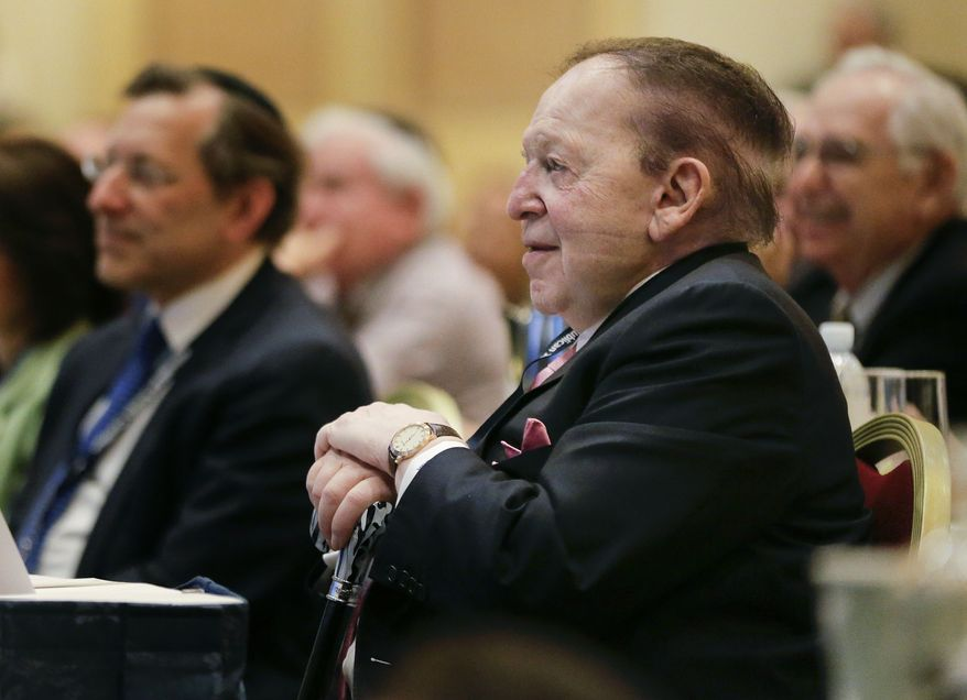 Sheldon Adelson listens as New Jersey Gov. Chris Christie speaks during the Republican Jewish Coalition, Saturday, March 29, 2014, in Las Vegas. Several possible GOP presidential candidates gathered in Las Vegas as Mr. Adelson, a billionaire casino magnate, looks for a new favorite to help on the 2016 race for the White House.  (AP Photo/Julie Jacobson)