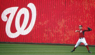Washington Nationals starting pitcher Stephen Strasburg (37) warms up before an exhibition baseball game against the Detroit Tigersat Nationals Park Saturday, March 29, 2014, in Washington. Strasburg is scheduled to start on opening day on March 31. (AP Photo/Alex Brandon)