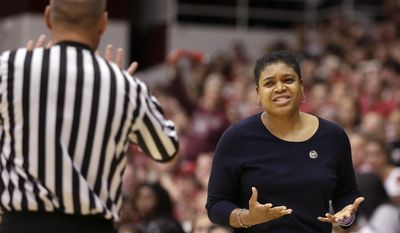 Penn State head coach Coquese Washington, right, gestures after an official made a call against Penn State during the first half of a regional semifinal game against Stanford at the NCAA college basketball tournament in Stanford , Calif., Sunday, March 30, 2014. (AP Photo/Jeff Chiu)