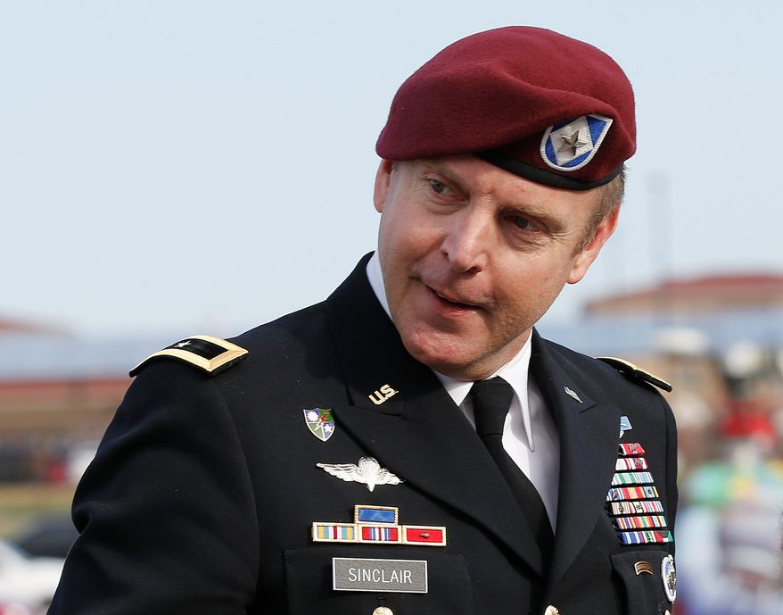 """In pressure cooker: In the case of Army Brig. Gen. Jeffrey Sinclair, charged with ethics violations and sexual assault in Afghanistan, the military judge said """"unlawful command influence"""" tainted the prosecution. (Associated Press)"""