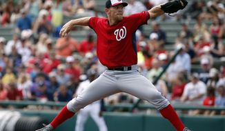 FILe - In this March 4, 2014 file photo,Washington Nationals starting pitcher Stephen Strasburg throws in a spring exhibition baseball game against the Atlanta Braves, in Kissimmee, Fla. With Bryce Harper and Strasburg fit after offseason surgery, and a rookie skipper in MattWilliams, the Nationals are hoping they'll live up to expectations this season. (AP Photo/Alex Brandon, File)