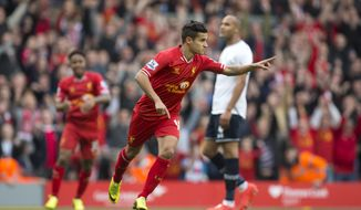 Liverpool's Philippe Coutinho celebrates after scoring against Tottenham during their English Premier League soccer match at Anfield Stadium, Liverpool, England, Sunday March 30, 2014. (AP Photo/Jon Super)