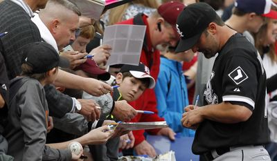 Paul Konerko signs autographs for fans before a spring exhibition baseball game against the Birmingham Barons on Friday, March 28, 2014, in Birmingham, Ala. (AP Photo/Butch Dill)