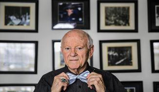 In this March 12, 2014 photo, Earl D'Amico, 84, poses for a portrait in Joliet, Ill. D'Amico is a former Joliet restauranteur and businessman. Through his businesses D'Amico brought a variety of entertainers to Joliet, including Count Basie, Duke Ellington, Guy Lombardo and Tina Turner. He shared some of his stories at the Joliet Area Historical Museum on March 16. (AP Photo/The Herald-News, Lathan Goumas)  MANDATORY CREDIT