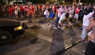 Students clashed against Tucson Police officers on University Avenue Saturday March 29, 2014 in Tucson, Ariz. after Arizona's loss to Wisconsin 64-63 in the West Region NCAA final. Projectiles were thrown at police from the crowd on the street. Tucson police Sgt. Pete Dugan says there were no immediate reports of injuries to fans or officers, but nine to 10 people were arrested.  (AP Photo/Arizona Daily Star, Carlos Herrera)