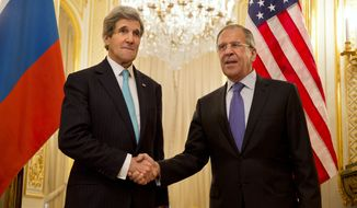 U.S. Secretary of State John Kerry, left, shakes hands with Russian Foreign Minister Sergey Lavrov before the start of their meeting at the Russian Ambassador's Residence to discuss Ukraine, in Paris, Sunday March 30, 2014. Kerry traveled to Paris for a last minute meeting with Lavrov. (AP Photo/Jacquelyn Martin, Pool)