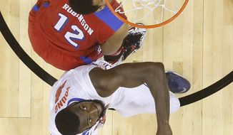 Dayton forward/center Jalen Robinson (12) watches his shot ball against Florida center Patric Young (4) during the second half in a regional final game at the NCAA college basketball tournament, Saturday, March 29, 2014, in Memphis, Tenn. Florida won 62-52. (AP Photo/John Bazemore)