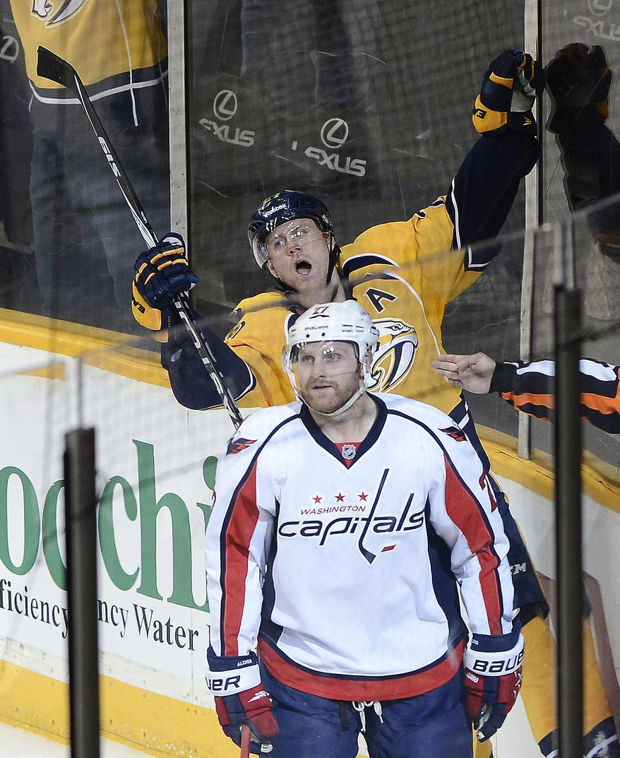 Nashville Predators forward Patric Hornqvist (27), of Sweden, celebrates behind Washington Capitals defenseman Karl Alzner (27) after scoring a goal in the first period of an NHL hockey game on Sunday, March 30, 2014, in Nashville, Tenn.  (AP Photo/Mark Zaleski)
