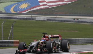Lotus driver Romain Grosjean of France steers his car during the third practice session for Sunday's Malaysian Formula One Grand Prix at Sepang International Circuit in Sepang, Malaysia, Saturday, March 29, 2014. (AP Photo/Peter Lim)