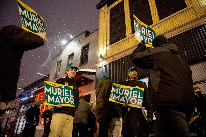 Supporters of Mayoral Candidate and Councilmember Muriel Bowser (D-Ward 4) gather outside a Washington, D.C. mayoral candidate forum held by the City Paper at the Black Cat nightclub on 14th Street, Washington, D.C., Sunday, March 16, 2014. (Andrew Harnik/The Washington Times)