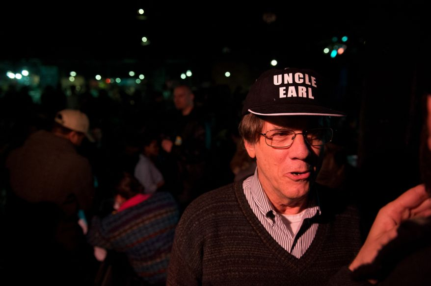 "A member of the audience wears an ""Uncle Earl"" hat, in reference to the nickname given to D.C. businessman Jeffrey Thompson, who allegedly gave illegal campaign contributions to Washington, D.C. Mayor Vincent Gray, at a  Mayoral campaign debate hosted by the Washington City Paper at the Black Cat on 14th St. in Northwest, Washington, D.C., Sunday, March 16, 2014. (Andrew Harnik/The Washington Times)"