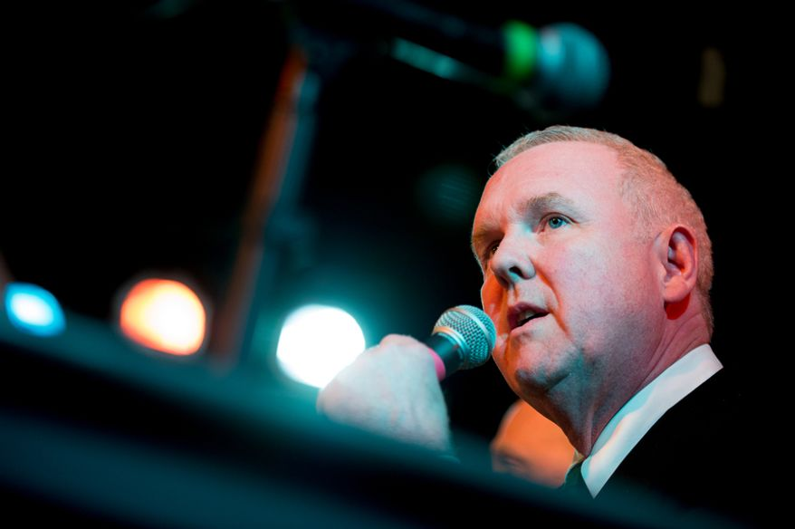 Washington, D.C. Councilmember Tommy Wells (D-Ward 6) speaks at a mayoral debate hosted by the Washington City Paper at the Black Cat on 14th Street in Northwest, Washington, D.C., Sunday, March 16, 2014. Incumbent Mayor Vincent Gray was invited but did not attend. (Andrew Harnik/The Washington Times)